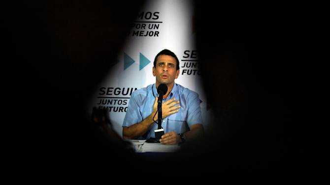 Venezuela's opposition leader Henrique Capriles recites a passage from the national constitution during a news conference in Caracas, Venezuela, Tuesday, Jan. 8, 2013. Capriles said that the Supreme Court should rule in a dispute between the opposition and President Hugo Chavez's government over whether the ailing leader's inauguration can legally be postponed. Capriles said the constitution is clear that the current presidential term ends on Jan. 10. Chavez remains in Havana after undergoing his fourth cancer surgery on Dec. 11 and hasn't spoken publicly in a month. (AP Photo/Fernando Llano)