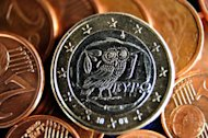 A 1 coin made in Greece and a pile of eurocents is pictured on May 21, 2012. Greece&#39;s four biggest banks need 27.5 billion euros ($36.4 billion) in recapitalisation funds, the national central bank said in a report released Thursday