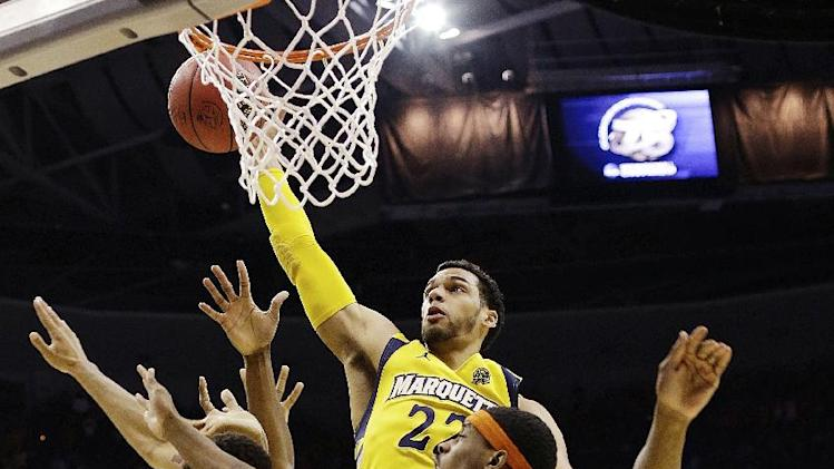 Marquette guard Trent Lockett (22) shoots user pressure from Syracuse forward C.J. Fair (5) during the first half of the East Regional final in the NCAA men's college basketball tournament, Saturday, March 30, 2013, in Washington. (AP Photo/Pablo Martinez Monsivais)