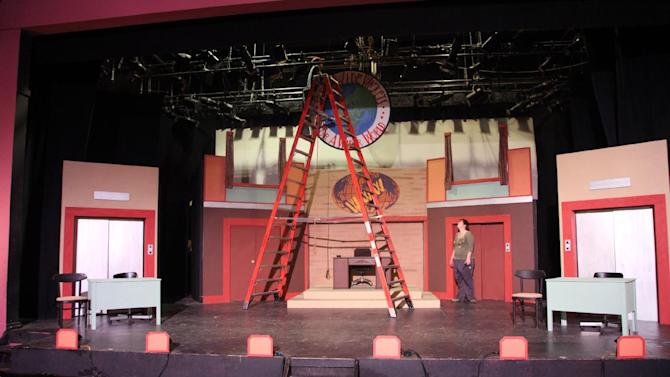 "This Thursday, Aug. 16, 2012, photo shows stagehands working on the set of ""How to Succeed in Business Without Really Trying"" before a performance at the summer camp Stagedoor Manor in Loch Sheldrake, N.Y. The camp, open to kids from 10 to 18, was started in 1976 and each year attracts campers from across the country as well as 19 nations including Thailand, Lebanon, Russia and Saudi Arabia.(AP Photo/Mark Kennedy)"