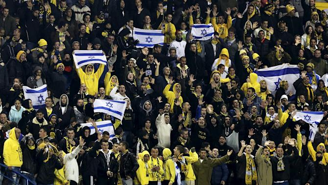File photo shows supporters of Beitar Jerusalem cheering their team during a soccer match in Jerusalem