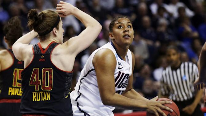 Connecticut forward Kaleena Mosqueda-Lewis, right, lines up a shot against Maryland guard Katie Rutan (40) during the second half of a women's NCAA college basketball regional semifinal in Bridgeport, Conn., Saturday, March 30, 2013.  Mosqueda-Lewis scored 17 points as Connecticut won 76-50. (AP Photo/Charles Krupa)