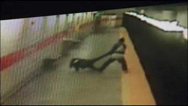 Video shows man tossing woman onto train tracks in Philadelphia