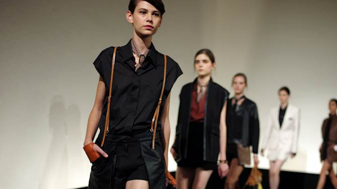 Models wear creations by French fashion designer Christophe Lemaire for Hermes' ready to wear Spring-Summer 2013 collection, presented in Paris, Sunday, Sept.30, 2012. (AP Photo/Thibault Camus)