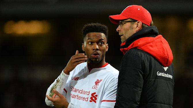 Liverpool's manager Jurgen Klopp speaks with striker Daniel Sturridge (L) during the English FA Cup fourth round replay match against West Ham United, on February 9, 2016
