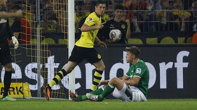 Robert Lewandowski scores for Dortmund v Bremen (Reuters)