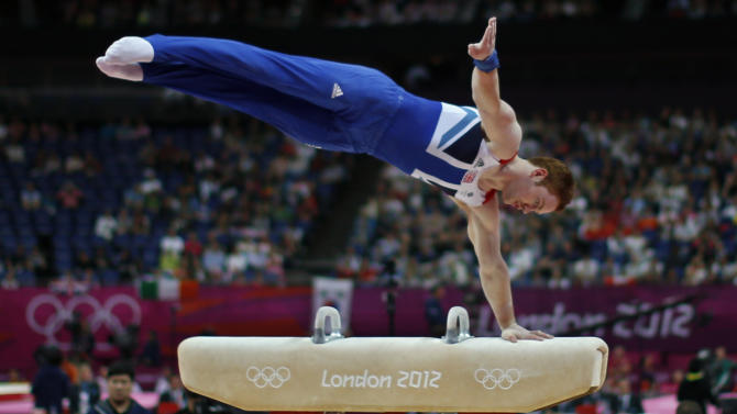 Great Britain's gymnast Daniel Purvis performs on the vault during the Artistic Gymnastic men's qualification at the 2012 Summer Olympics, Saturday, July 28, 2012, in London. (AP Photo/Matt Dunham)