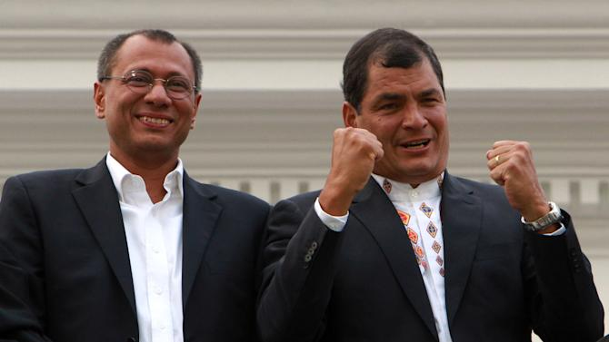 Ecuador's President and candidate for re-election Rafael Correa, right, and vice presidential candidate Jorge Glass celebrate after presidential elections in Quito, Ecuador, Sunday, Feb. 17, 2013. Although official results had still not been released, Correa celebrated his second re-election as Ecuador's president after an exit poll showed him leading by a wide margin. (AP Photo/Martin Jaramillo)
