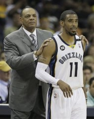 Memphis Grizzlies head coach Lionel Hollins holds Memphis Grizzlies point guard Mike Conley (11)in the closing moments of the second half of Game 3 in a Western Conference semifinal NBA basketball playoff series against the Oklahoma City Thunder, in Memphis, Tenn., Saturday, May 11, 2013. The Grizzlies defeated the Thunder 87-81. (AP Photo/Danny Johnston)