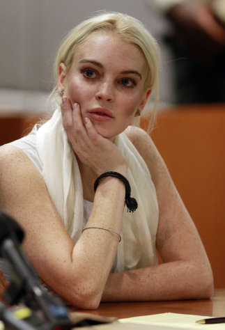 Lindsay Lohan is seen in court before being taken into custody by Los Angeles Country sheriffs deputies after a judge found her in violation of probation Wednesday, Oct. 19, 2011, in Los Angeles. (AP Photo/Mark Boster, Pool)