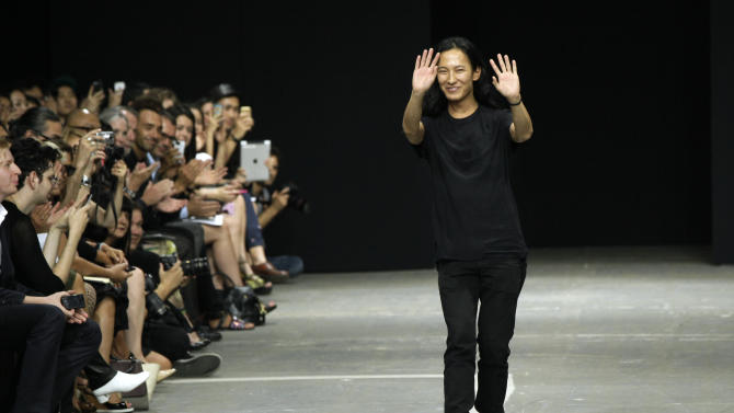 FILE - This Sept. 8, 2012 file photo shows designer Alexander Wang after his Spring 2013 collection was modeled during Fashion Week, in New York. Wang is taking over the creative direction of storied Paris fashion house Balenciaga.The company made the announcement on Monday, Dec. 3, that 28-year-old Wang would fill the spot vacated last month by Nicolas Ghesquiere. (AP Photo/Richard Drew, file)