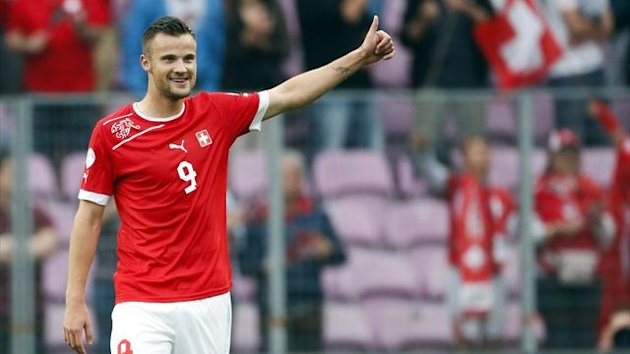 Switzerland's Haris Seferovic celebrates their 2014 World Cup qualifying soccer match victory against Cyprus in Geneva, June 8, 2013. REUTERS