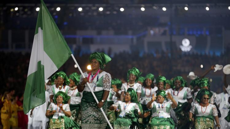 The flag of Nigeria is carried by Maryam Usman as the team enters the stadium during the opening ceremony for the 2014 Commonwealth Games at Celtic Park in Glasgow