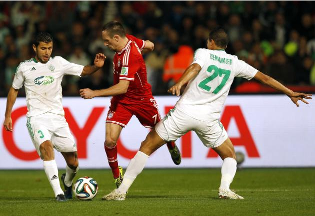 Benlamalem and El Hachimi of Morocco's Raja Casablanca fight for the ball with Ribery of Germany's Bayern Munich during their 2013 FIFA Club World Cup final soccer match at Marrakech stadium