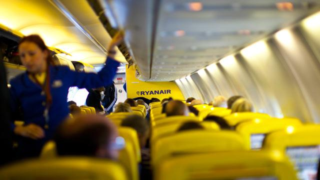 RyanAir Standing Up Against Seat Belts