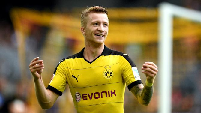 Dortmund's striker Marco Reus celebrates scoring during a Bundesliga match against Borussia Moenchengladbach in Dortmund on August 15, 2015