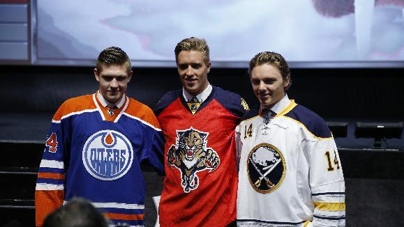 From left, Edmonton Oilers' Leon Draisaitl, Florida Panthers' Aaron Ekblad and Buffalo Sabres' Sam Reinhart pose for photographs during the first round of the NHL hockey draft, Friday, June 27, 2014, in Philadelphia