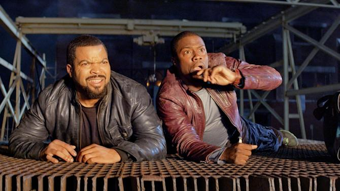 """This image released by Universal Pictures shows Ice Cube, left, and Kevin Hart in a scene from the film, """"Ride Along."""" (AP Photo/Universal Pictures, file)"""