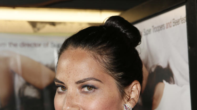 Commercial Image - Olivia Munn attends a screening of Millennium Entertainment's 'The Babymakers' at the Silent Movie Theatre on Tuesday July 24, 2012 in Los Angeles.  (Photo by Todd Williamson/Invision for Millennium Entertainment /AP Images)