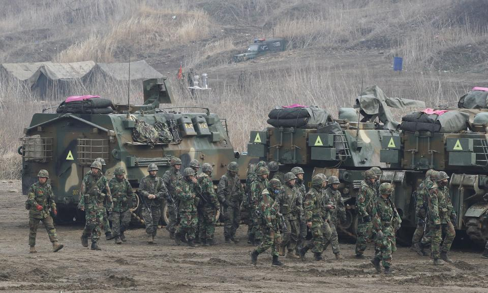 South Korean Marines pass by K-55 self-propelled howitzers during an exercise against possible attacks by North Korea near the border village of Panmunjom in Paju, South Korea, Wednesday, April 3, 2013. (AP Photo/Ahn Young-joon)