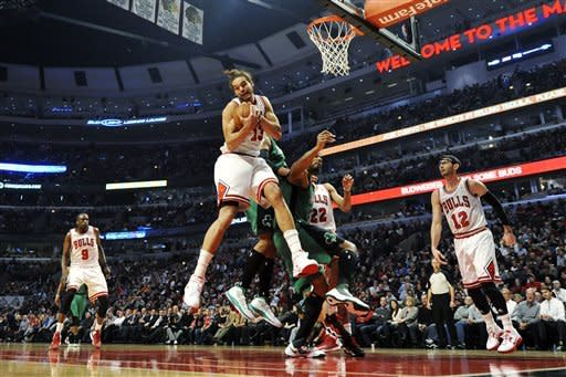 Deng, Boozer score 21 as Bulls beat Celtics 100-89