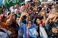 Activists of the ruling Pakistan Peoples Party (PPP) shout slogans during a protest against the contempt of court verdict handed to Pakistan prime minister Yousuf Gilani, in Lahore. Pakistan's prime minister refused to step down Friday as he made a defiant appearance in parliament a day after his conviction over a corruption investigation into the president