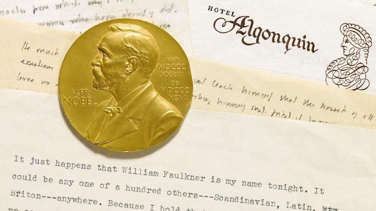 This undated photo provided by Sotheby's shows the 1950 Nobel Prize medal awarded to William Faulkner and a draft of his acceptance speech for his Nobel Prize for Literature. Manuscripts and personal letters of the late author, whose original writings are a rarity in the literary marketplace, can be viewed Wednesday, April 10, 2013, at Sotheby's in New York -  an event to whet the appetites of scholars ahead of a June 11 auction. (AP Photo/Sotheby's)