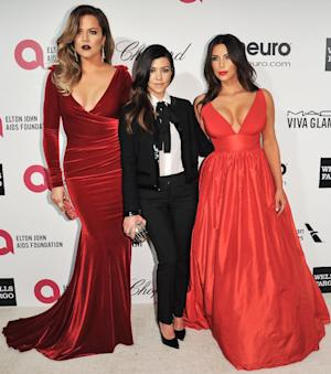 Khloe Kardashian, from left, Kourtney Kardashian, and …