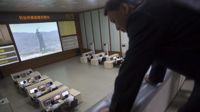 A North Korean man looks down from a balcony at North Korea's space agency's General Launch Command Center on the outskirts of  Pyongyang Wednesday, April 11, 2012. Engineers are pumping fuel into a rocket that is set to carry a satellite into space, officials at the North Korean space agency's central command center said Wednesday, showing reporters a live feed of the west coast launch pad. (AP Photo/David Guttenfelder)