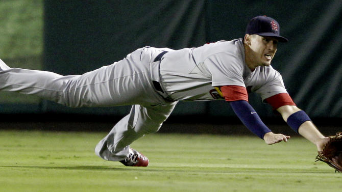 St. Louis Cardinals' Allen Craig can't come up with a double hit by Texas Rangers' Elvis Andrus during the seventh inning of Game 4 of baseball's World Series Sunday, Oct. 23, 2011, in Arlington, Texas. (AP Photo/Matt Slocum)