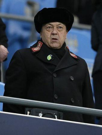 West Ham United's co-owner Sullivan watches ahead of their English League Cup semi-final first leg soccer match against Manchester City at the Etihad Stadium in Manchester