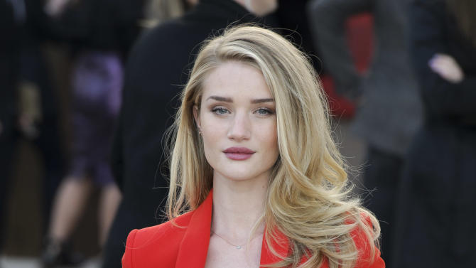 British actress Rosie Huntington-Whiteley arrives for the Burberry Prorsum fashion collection during London Fashion Week, at a central London Venue, Monday, Feb. 18, 2013, London. (Photo by Jonathan Short/Invision/AP)