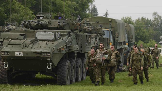 Troops from the 3rd Canadian Division, tasked with reinforcing the battle against wildfires in northern Saskatchewan, arrive in Prince Albert