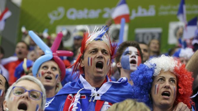 Supporters of France cheer their team before the quarterfinal match of the 24th Men's Handball World Championship against Slovenia in Doha