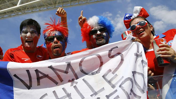 Fans of Chile cheer before the start of the 2014 World Cup Group B soccer match against Netherlands at the Corinthians arena in Sao Paulo