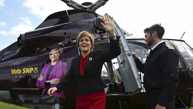 Leader of the Scottish National Party Sturgeon waves as she exits her campaign helicopter in Gourock, Scotland