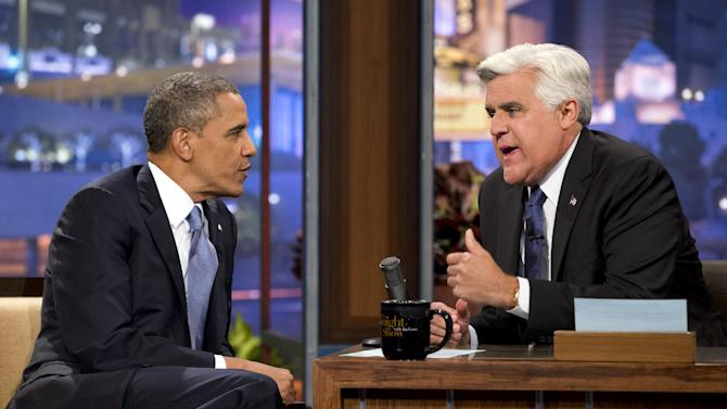 """President Barack Obama, left, talks with Jay Leno during a commercial break during the taping of his appearance on """"The Tonight Show with Jay Leno"""" in Los Angeles, Tuesday, Aug. 6, 2013. (AP Photo/Jacquelyn Martin)"""