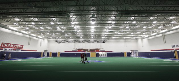 Students walk across the indoor practice field that is part of the new  $60 million football stadium at Allen High School Tuesday, Aug. 28, 2012 in Allen, Texas. Allen High School northeast of Dallas