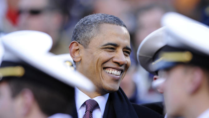 President Barack Obama visits with Navy Midshipmen in the stands in the first half of the 112th edition of the annual Army vs. Navy NCAA college football game at FedEx Field in Landover, Md., Saturday, Dec. 10, 2011.  (AP Photo/Nick Wass)