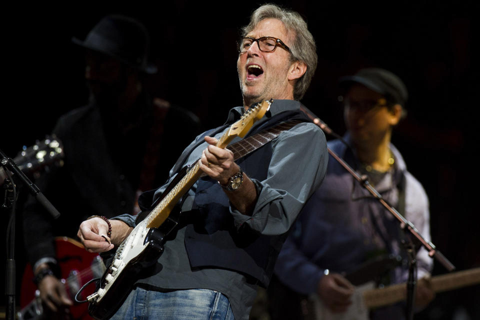 Eric Clapton performs at Eric Clapton's Crossroads Guitar Festival 2013 at Madison Square Garden on Sunday, April 14, 2013, in New York. (Photo by Charles Sykes/Invision/AP)