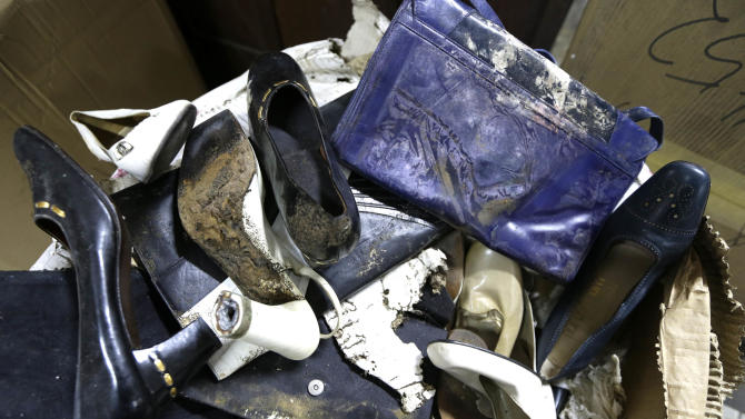 In this photo taken Sept. 19, 2012, branded high heel shoes, once worn by flamboyant former Philippine first lady Imelda Marcos, sit among equally-damaged shoes and bags in a section of the National Museum in Manila, Philippine. Termites, storms and government neglect have damaged some of Imelda Marcos's legendary stash of shoes, expensive gowns and other vanity possessions, which were left to oblivion after she and her dictator husband were driven to U.S. exile by a 1986 popular revolt. (AP Photo/Bullit Marquez)