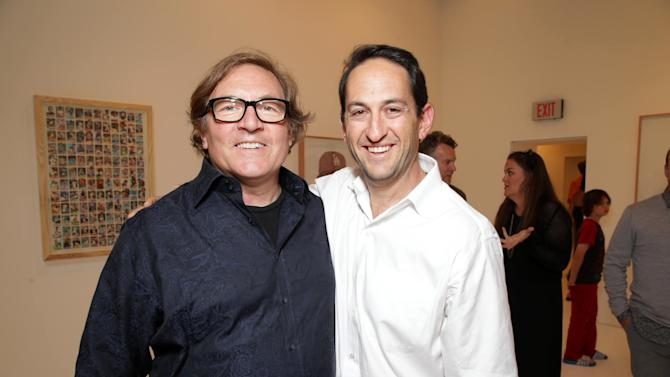EXCLUSIVE CONTENT - PREMIUM RATES APPLY Producer Lorenzo Di Bonaventura and Warner Bros.' Greg Silverman at Artist Pat Riot's Art Exhibit, 'Out of Left Field' benefiting the MLB Urban Youth Academy on Thusday, May, 23rd, 2013 in Los Angeles. (Photo by Eric Charbonneau/Invision for Protagonist Brand Management/AP Images)