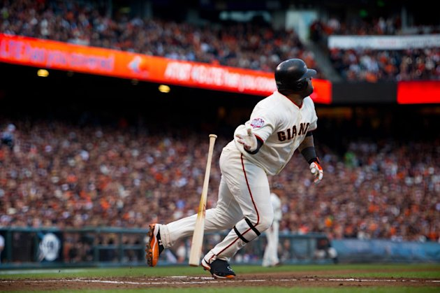 San Francisco Giants' Pablo Sandoval (48) watches his solo home run against the Detroit Tigers in the first inning during Game 1 of baseball's World Series on Wednesday, Oct. 24, 2012, in San