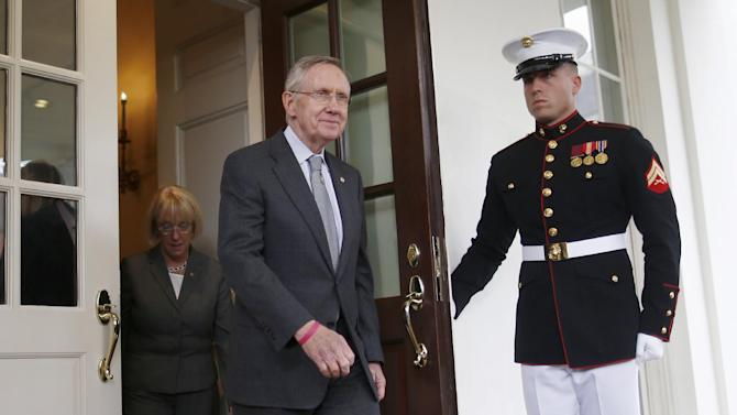 A Marine honor guard holds open the door to the West Wing of the White House in Washington, Thursday, Oct. 10,2013, as Senate Majority Leader Harry Reid of Nev. and Senate Budget Committee Chair Sen. Patty Murray, D-Wash., walk out to talk to reporters following a meeting with President Barack Obama regarding the government shutdown and debt ceiling. (AP Photo/Charles Dharapak)
