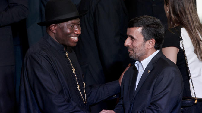 Iran President Mahmoud Ahmadinejad, right, shakes hands with Nigeria's President Goodluck Ebele Jonathan, left, before the group photo at the United Nations Conference on Sustainable Development, or Rio+20, in Rio de Janeiro, Brazil, Wednesday, June 20, 2012. The Earth summit runs through June 22. (AP Photo/Victor R. Caivano)