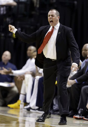 Indiana Pacers coach Frank Vogel screams at an official, as he receives the first of two consecutive technical fouls in the second half of an NBA basketball game against the Cleveland Cavaliers in Indianapolis, Tuesday, April 9, 2013. The Pacers defeated the Cavaliers 99-94