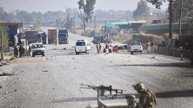 Afghan security forces block the road where Taliban suicide bombers attacked a joint U.S.- Afghan air base in Jalalabad, east of Kabul, Afghanistan on Sunday, Dec. 2, 2012. The suicide bombers attacked early Sunday, detonating explosives at the gate and sparking a gunbattle that lasted at least two hours with American helicopters firing down at militants before the attackers were defeated. (AP Photo/Nasrullah Khan)