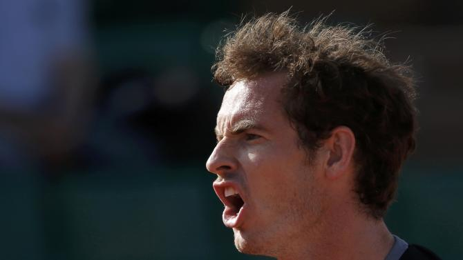 Andy Murray of Britain reacts during his men's quarter-final match against David Ferrer of Spain during the French Open tennis tournament at the Roland Garros stadium in Paris