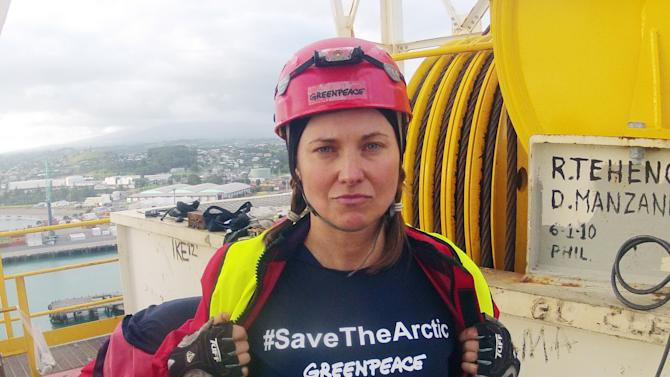 """FILE - In this Feb. 24, 2012 file photo provided by Greenpeace, actress Lucy Lawless joins activists in stopping a Shell-contracted drillship from departing the port of Taranaki, New Zealand. Lawless says she has """"no regrets"""" for boarding a ship in a protest action which on Thursday, June 14, 2012 resulted in her pleading guilty to trespass charges. (AP Photo/Greenpeace, File) EDITORIAL USE ONLY"""