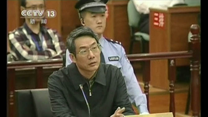 Still image taken from video shows former deputy head of China's top planning agency, The National Development and Reform Commission, Liu during his trial at Intermediate People's Court in Langfang, Hebei province